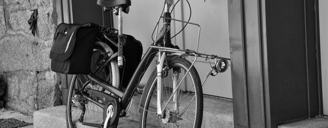 bicycle leaning against door