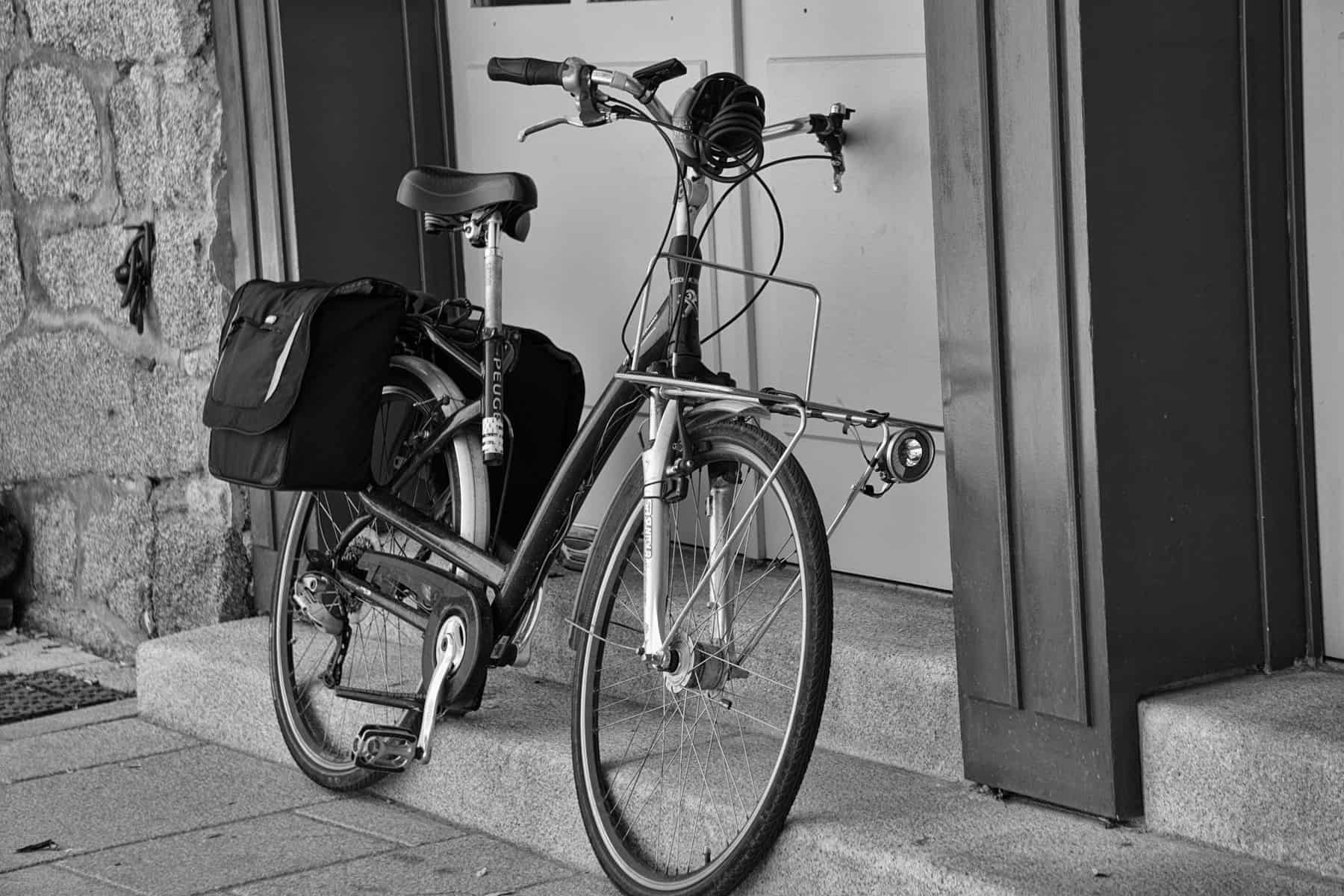 bicycle leaning against door