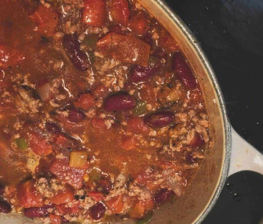 chili cooking in dutch oven
