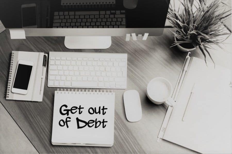 get out of debt by living half your income