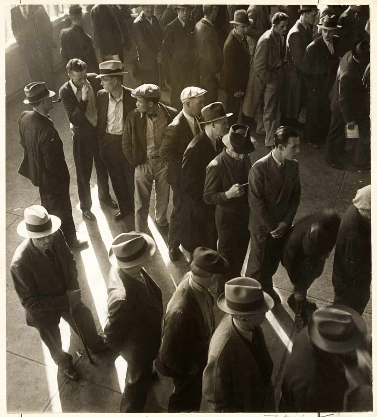 jobless men lined up during the great depression.