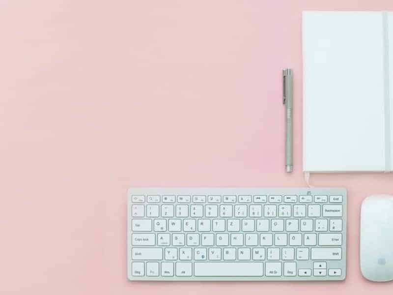 keyboard and mouse on pink table