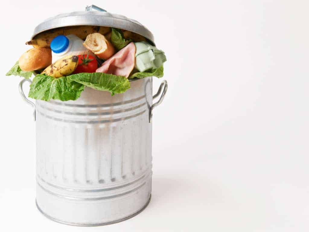 food scraps in metal trash can.