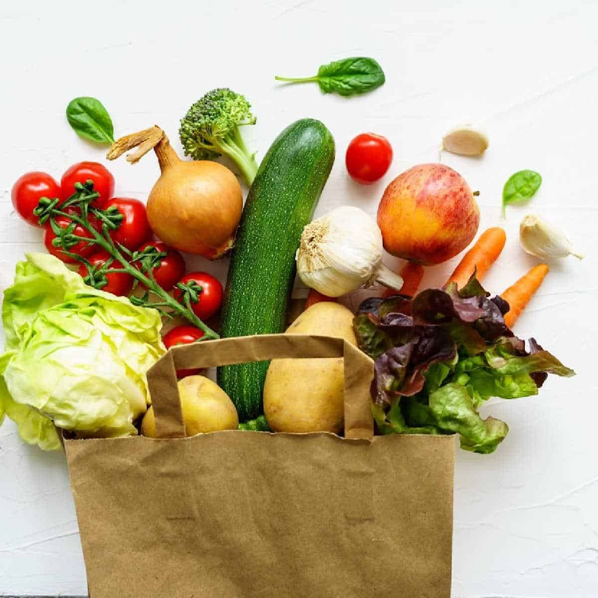 paper grocery bag filled with fruits and vegetables.