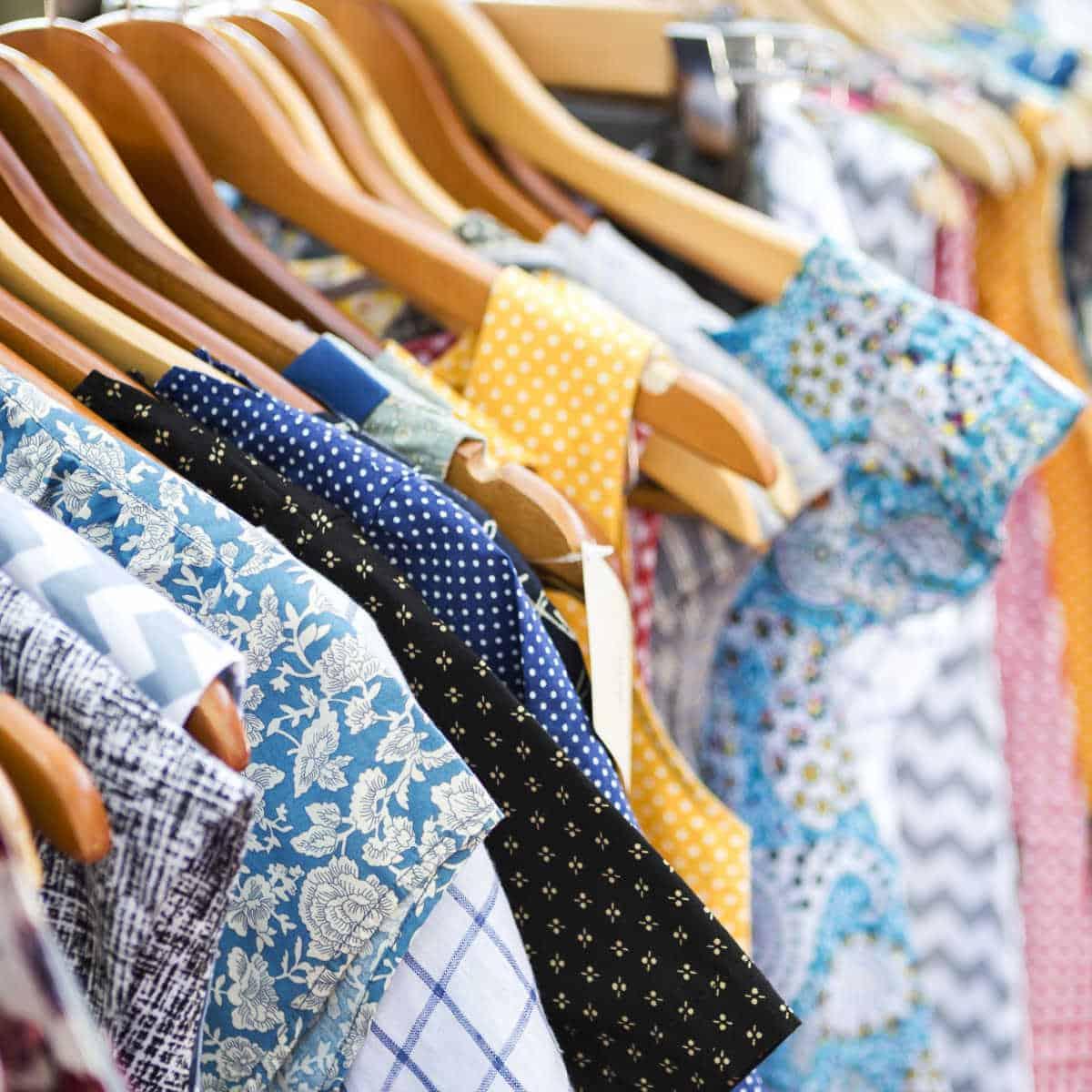 thrift store womens clothing on racks.